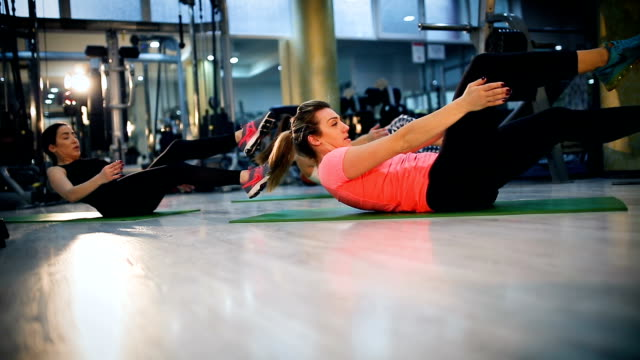 pilates class exercising at fitness studio - strongwoman stock videos & royalty-free footage