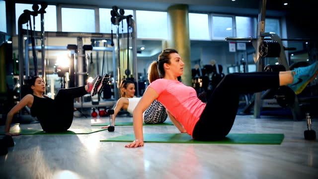pilates class exercising at fitness studio - exercise class stock videos & royalty-free footage