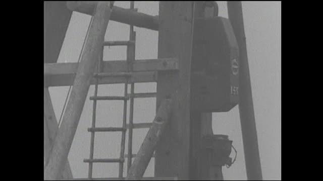 vídeos de stock, filmes e b-roll de a pile driver pounds pipes into the sumida river during construction of a subway. - pile driver