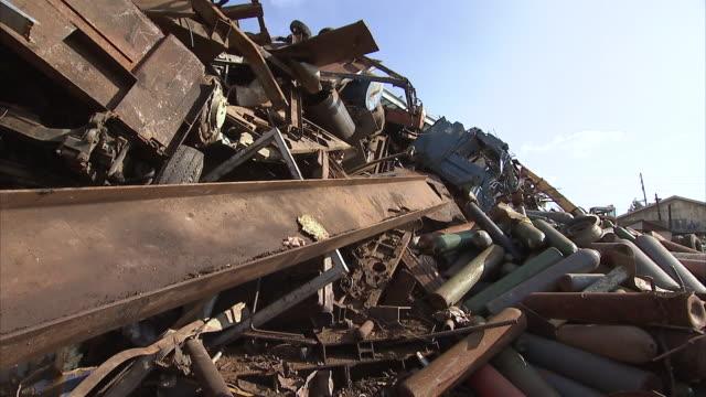 MS PAN Pile in junkyard under sky / Los Angeles, California, USA