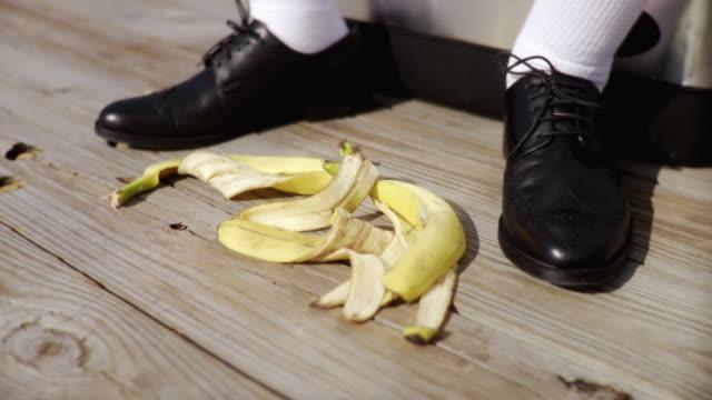 cu pile of bananas peels at mans feet / jacksonville beach, florida, usa   - cool box stock videos & royalty-free footage