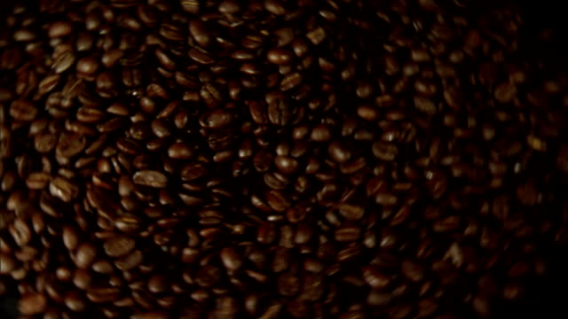 a pile of coffee beans spins. - turning stock videos & royalty-free footage