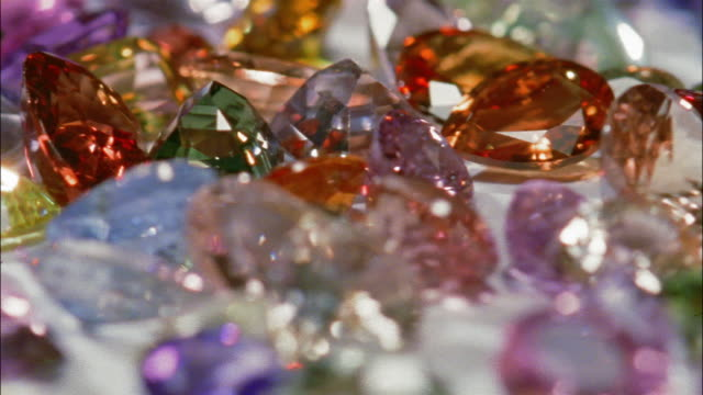 A pile of colorful gemstones spins around.