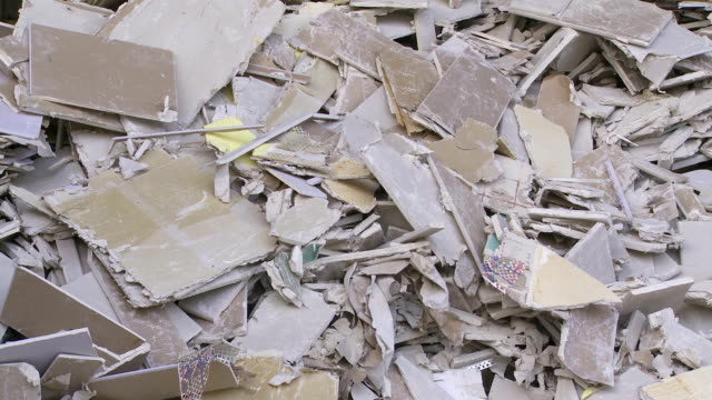 pile of drywall garbage in a recycling center - stack of plates stock videos & royalty-free footage