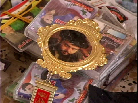 stockvideo's en b-roll-footage met pile of evidence seized during raid including photo of shi'ite leader muqtada al-sadr / mahmudiyah, iraq / audio - mannelijke gelijkenis