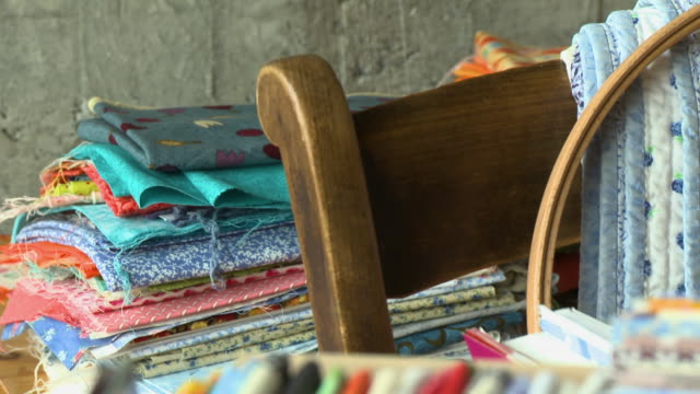 pile of fabrics, wooden chair - folded stock videos & royalty-free footage