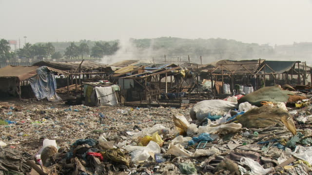 Pile of garbage around Manila slum
