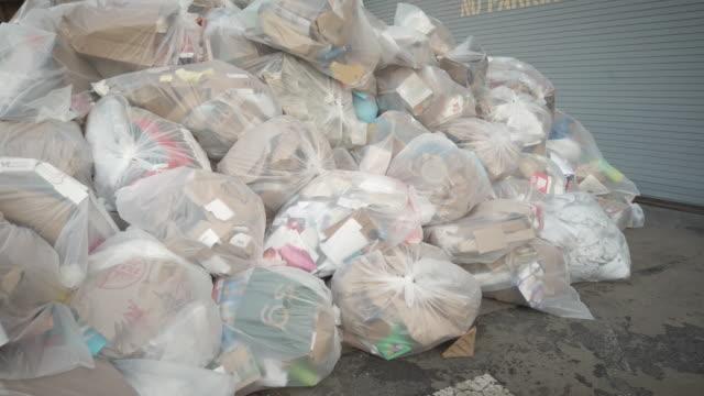 a pile of garbage bags in brooklyn - sopsäck bildbanksvideor och videomaterial från bakom kulisserna