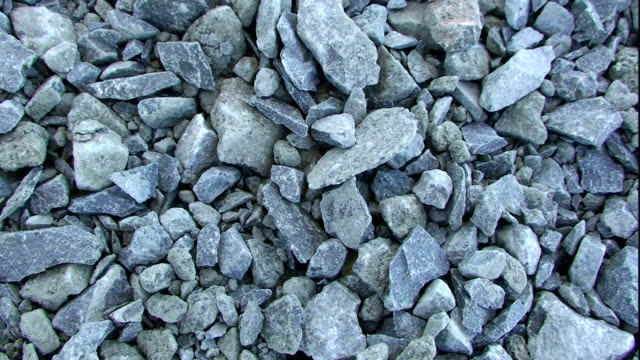 a pile of gravel lies on the ground. - gravel stock videos & royalty-free footage