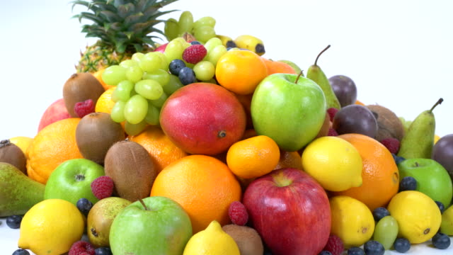 pile of healthy fruits on white in 4k - kiwi fruit stock videos and b-roll footage