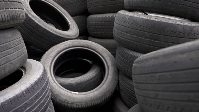 pile of old vehicle tires in warehouse. - heap stock videos & royalty-free footage