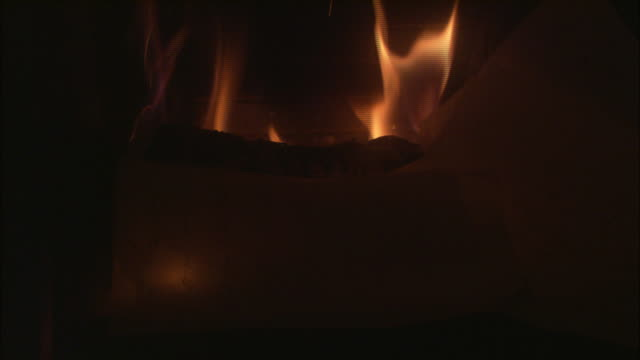 a pile of papers falls over a fire in a fireplace and begins to burn. - edinburgh scotland stock videos & royalty-free footage