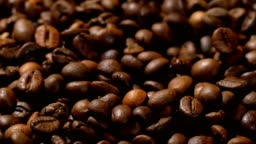 pile of roasted coffee beans falling down
