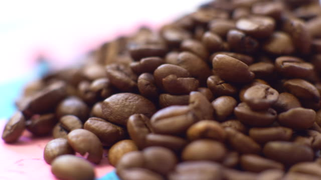 pile of roasted coffee beans rotate - coffee drink stock videos & royalty-free footage