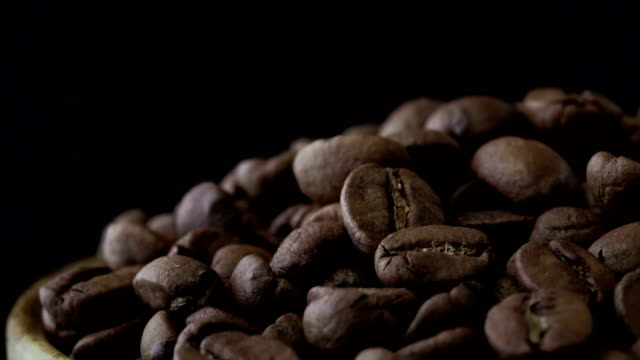 a pile of shelled coffee bean rotating slowly - mocha stock videos and b-roll footage