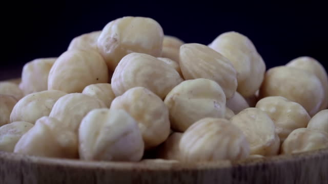 4k a pile of shelled hazelnuts rotating slowly - hazel eyes stock videos & royalty-free footage
