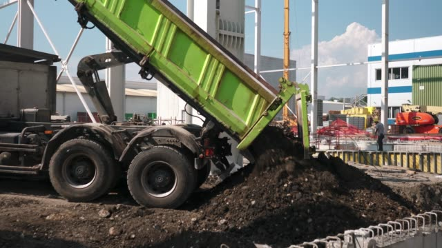 pile of soil is being dumped on the construction site - agricultural machinery stock videos & royalty-free footage