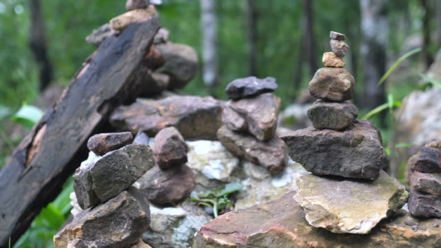 pile of stones in a forest - balance stock videos & royalty-free footage