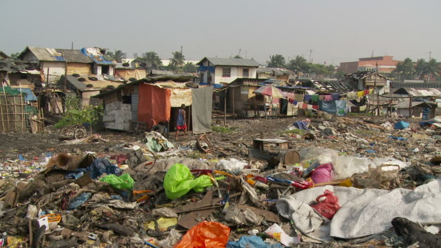 pile of trash in manila slum - slum stock-videos und b-roll-filmmaterial