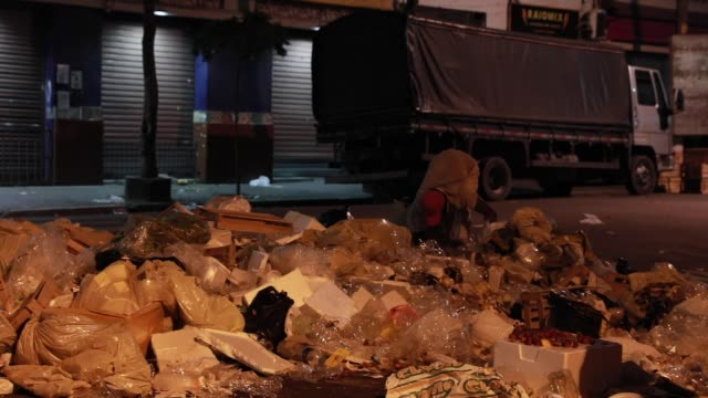 a pile of trash is seen next to where homeless people sleep on august 29 2020 in sao paulo brazil according to an official survey by the municipality... - 25 29 years stock videos & royalty-free footage
