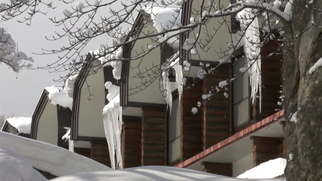 piled up snow and hanging icicle, aomori, japan - oirase river stock videos & royalty-free footage