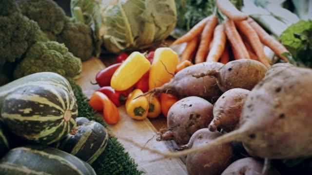Piled Up Vegetables on Market Stall