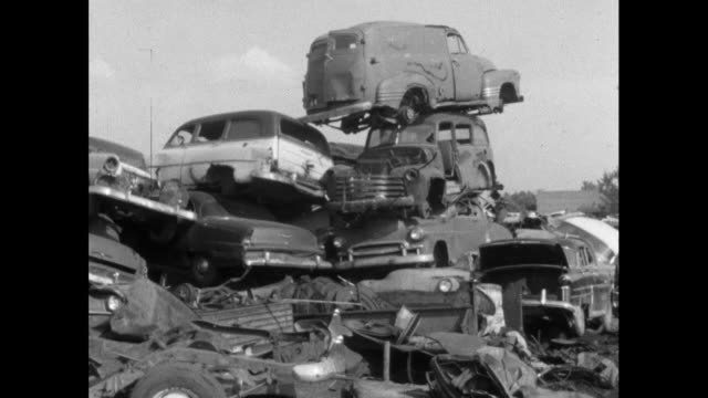 ws piles of abandoned american cars in scrapyard; 1964 - automobile industry stock videos & royalty-free footage