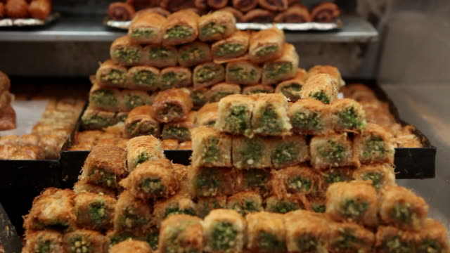 Piles of baklawa, a traditional Middle-Eastern dessert, line a shelf at the Ben Yehuda Market in Jerusalem.