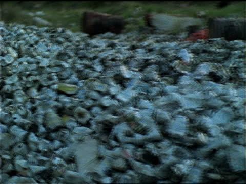 vídeos de stock e filmes b-roll de piles of empty cans and other garbage litter the great savanna in venezuela. - depósito de lixo