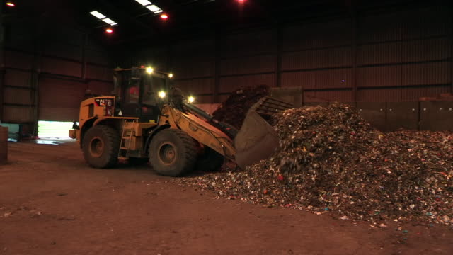 piles of food waste are scooped up and moved - newcastle upon tyne stock-videos und b-roll-filmmaterial