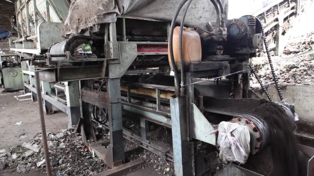 Piles of nonsegregated waste are loaded into a separator machine at the Infrastructure Leasing Services Ltd compost plant in Mysuru Karnataka India...