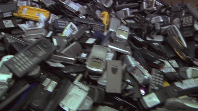 cu piles of obsolete and broken cell phones / dexter, michigan, usa - obsoleto video stock e b–roll