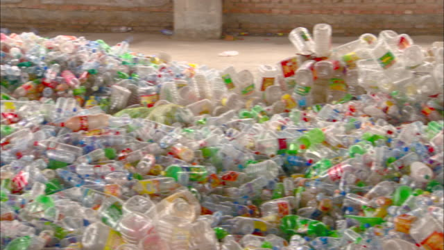 cu pan piles of plastic bottles in recycling center, beijing, beijing, china - bottle stock videos & royalty-free footage