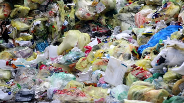 piles of plastic waste tilt up - bundle stock videos & royalty-free footage
