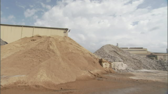 piles of rock and dirt surround a lead mining site. - lead stock videos & royalty-free footage