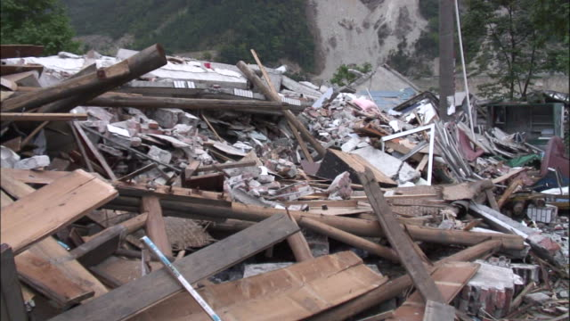 piles of rubble provide evidence of the extensive damage caused by the 2008 earthquake in sichuan china - earthquake stock videos & royalty-free footage