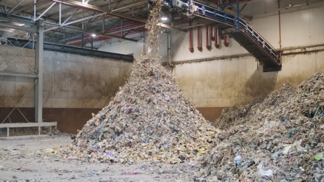 piles of separated recyclables inside waste facility - plant stock videos & royalty-free footage