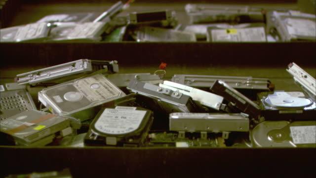 CU Piles of used hard drives on conveyor belt, Birmingham, UK