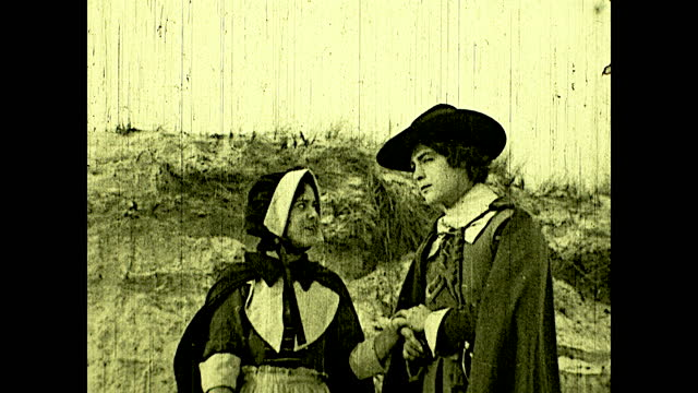 pilgrim couple waving goodbye to the mayflower on the ocean's horizon. historical reenactment of early american colonial history. - pilgrim stock videos & royalty-free footage