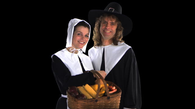 pilgrim couple with basket - this clip has an embedded alpha-channel - pre matted stock-videos und b-roll-filmmaterial