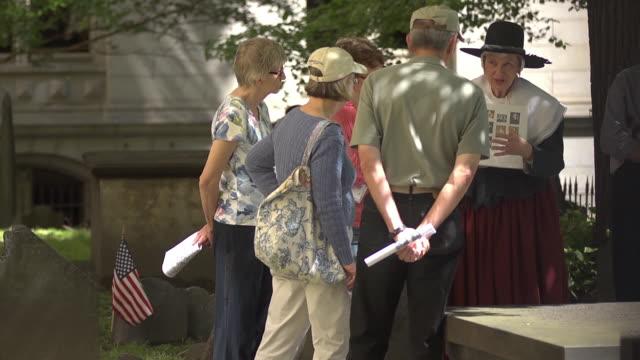 pilgrim talking to tourists in cemetery - pilgrim stock videos & royalty-free footage