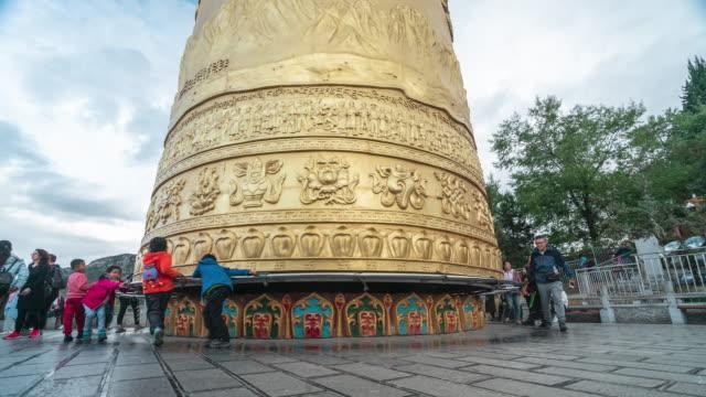 pilgrim with big prayer wheel at shangri-la tibet temple, time lapse - pilgrim stock videos & royalty-free footage