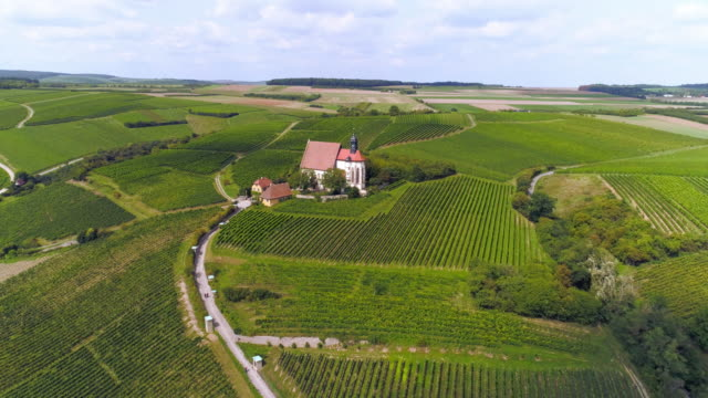 pilgrimage church maria im weingarten (st. mary in the vineyard) near volkach in franconia - inquadratura da un aereo video stock e b–roll