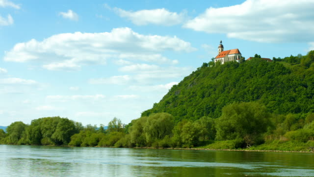 pan pilgrimage church on bogenberg mountain above the danube river - river danube stock videos & royalty-free footage