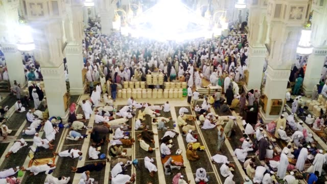 pilgrims after prayer moving out and resting in side the al haram mosque - moving after stock videos & royalty-free footage