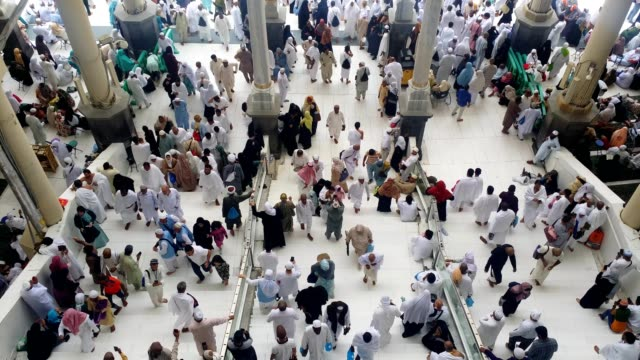 pilgrims after prayer time in side the al haram mosque - hajj stock videos & royalty-free footage