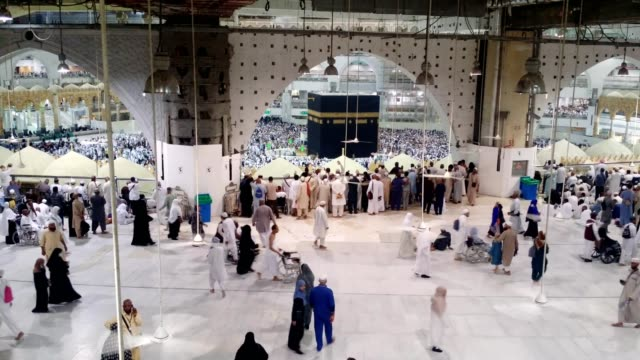pilgrims circling around kabah on wheelchair for umrah - kabah stock videos and b-roll footage