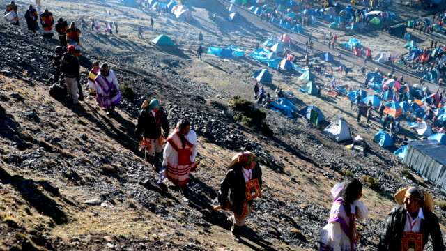 pilgrims descend descend the mountain after ceremonies during the annual qoyllur rit'i festival on may 29, 2018 in ocongate, peru. every year, since... - religious celebration stock videos & royalty-free footage