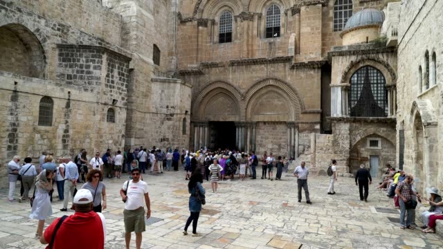 Pilgrims enter the Church of the Holy Sepulchre in the old city