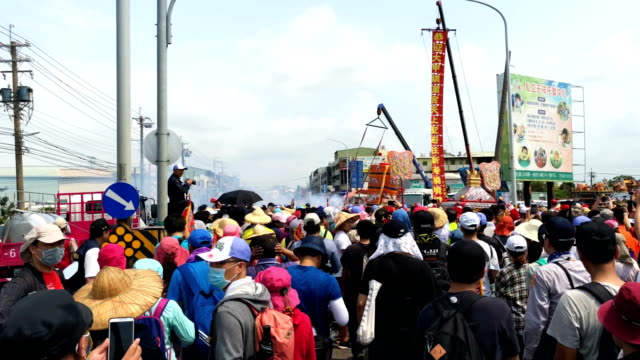 pilgrims follow the sedan chair carrying a statue of the goddess mazu on day two of the nine day mazu pilgrimage on april 14 2018 in dadu taiwan the... - sedan stock videos & royalty-free footage
